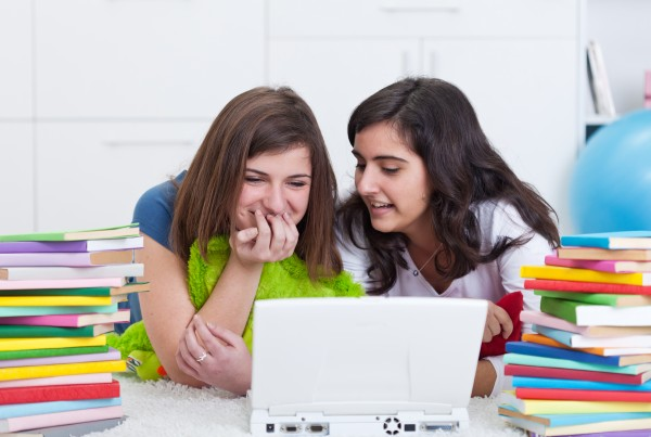 Teen girls having fun searching the internet together
